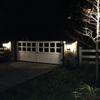 Mahogany entrance gate at night