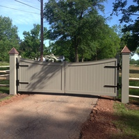 Red cedar entrance gate stained solid color